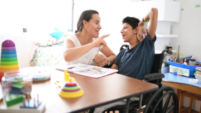mother playing with son with cerebral palsy - cerebral palsy stock videos & royalty-free footage