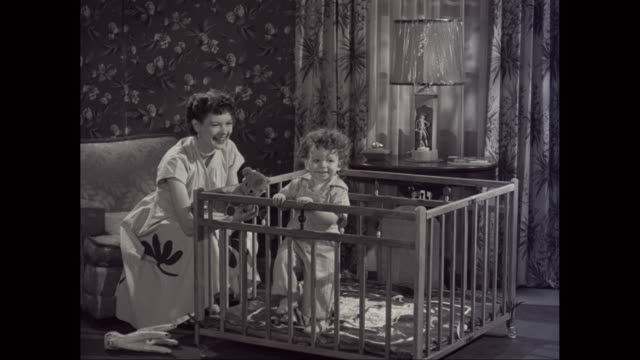 vídeos de stock e filmes b-roll de ws mother playing with toddler boy in domestic room / united states - papel de parede