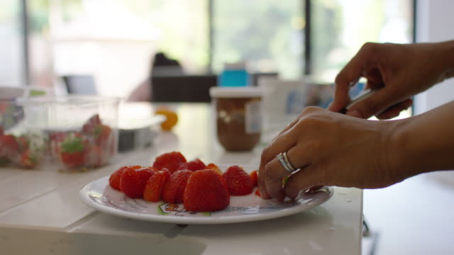 a mother prepares breakfast for her children - david bond stock videos & royalty-free footage