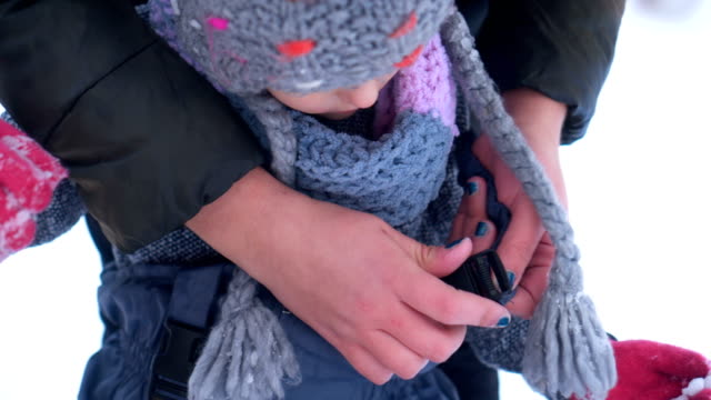 mother prepares daughter for snow - warm clothing stock videos & royalty-free footage