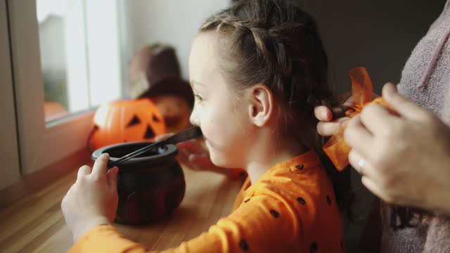 mother preparing her little girl for halloween - fancy dress costume stock videos & royalty-free footage