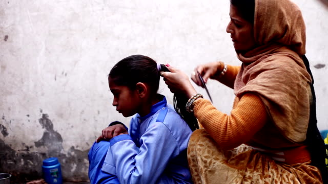 mother preparing little girl for school - poor family stock videos & royalty-free footage