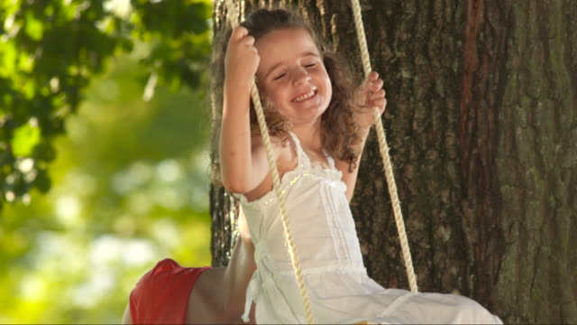 hd slow motion: mother pushing little girl on swing - swinging stock videos & royalty-free footage