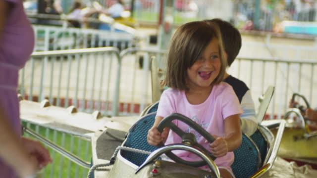 ms mother putting children (2-5) on amusement park ride / rutland, vermont, usa - bumper car stock videos & royalty-free footage