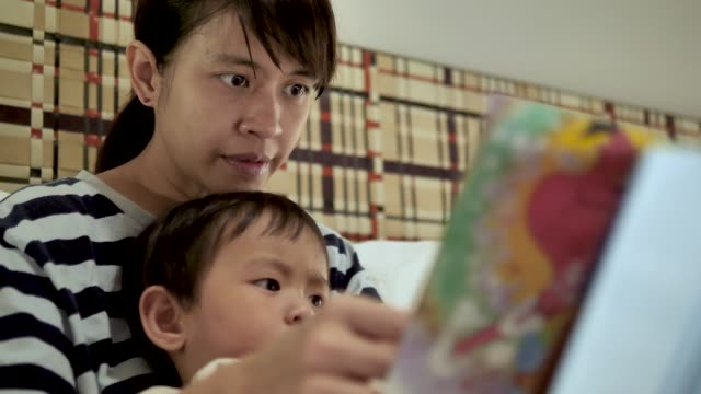 mother read a book to her son at home. - picture book stock videos and b-roll footage