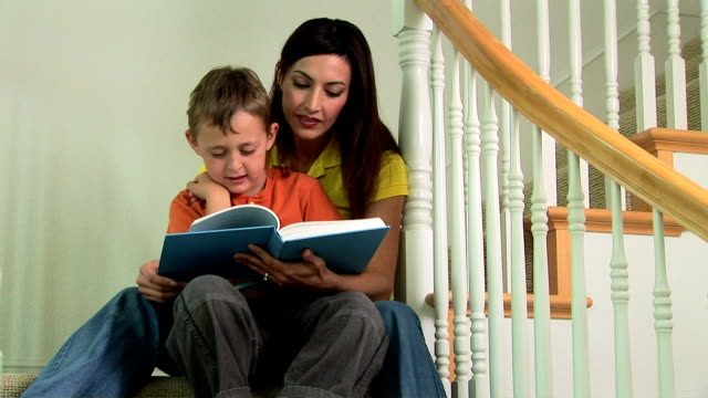 mother reading to son - three quarter length stock videos & royalty-free footage