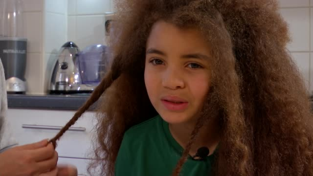 mother refuses to cut son's hair to meet school guidelines; england: london: int bonnie miller sat with farouk james's farouk james interview as... - cut video transition stock videos & royalty-free footage
