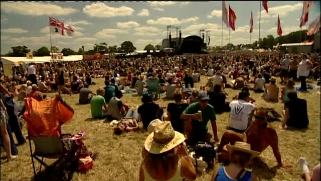 Mother returns to Glastonbury festival the day after giving birth Somerset Glastonbury Crowd at Glastonbury festival PAN across tents Wide shot of...