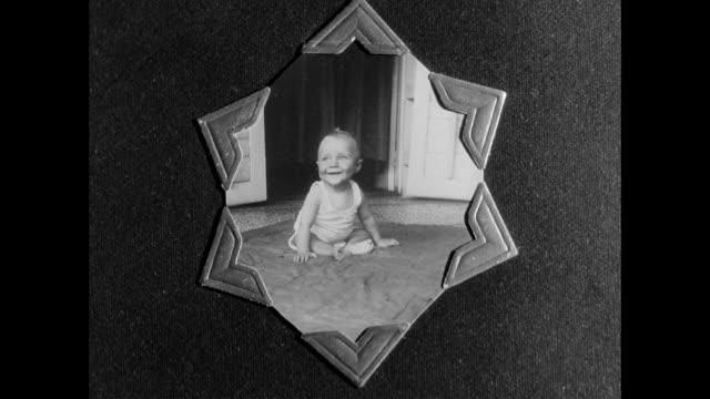 vídeos de stock e filmes b-roll de montage mother showing a photo album of her son / united kingdom - super exposto