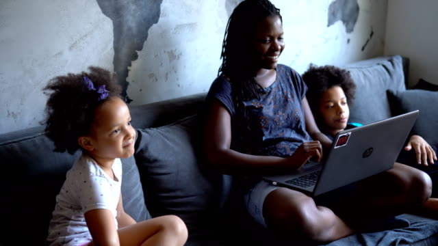 mother surfing the net with her daughters - concrete wall stock videos & royalty-free footage