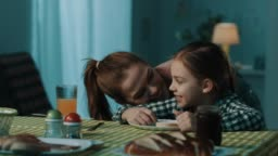 Mother surprising daughter at dining table