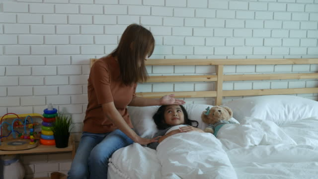 mother take care her patient girl - thermometer stock videos & royalty-free footage