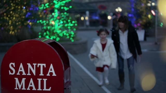 mother takes girl to mailbox to sent letter to santa claus - mailbox stock videos & royalty-free footage