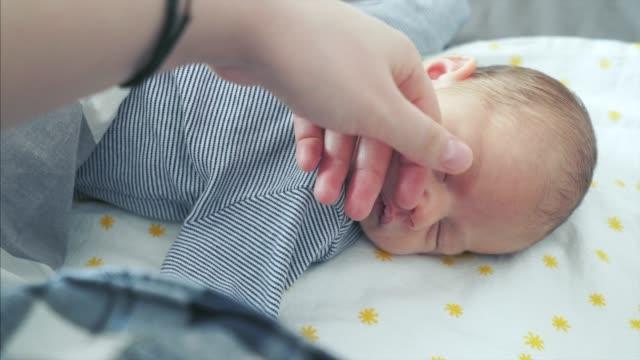 POV Mother taking care of her newborn child.