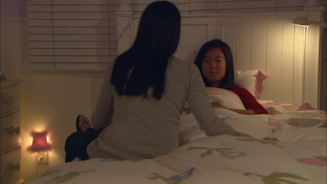 ms, mother taking daughter's (10-11) temperature - zurücklehnen stock-videos und b-roll-filmmaterial