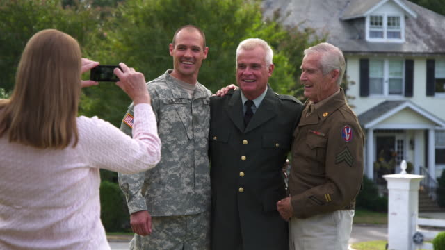 WS Mother Taking Photograph of Three Generations of Men in Military Uniform / Richmond, Virginia, United States