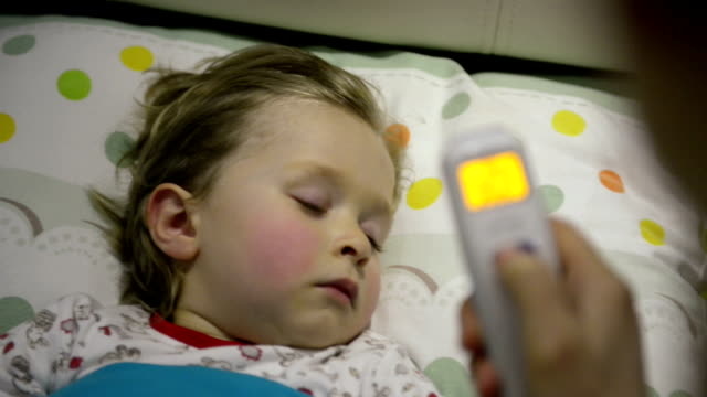 mother taking the son's temperature - illness stock videos & royalty-free footage