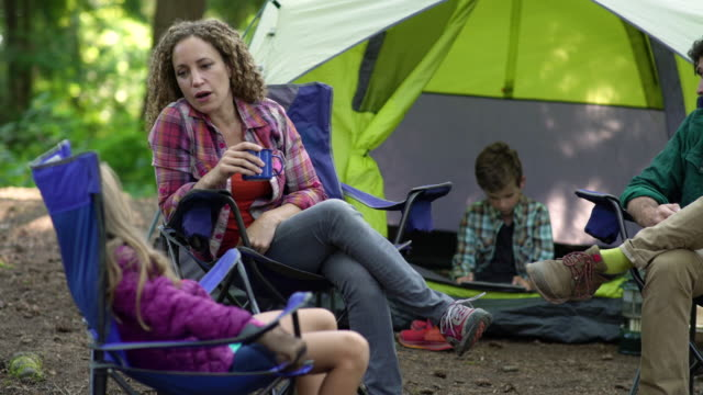 mother talking to daughter on camping trip