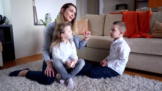 mother talking with children at home - parent stock videos & royalty-free footage