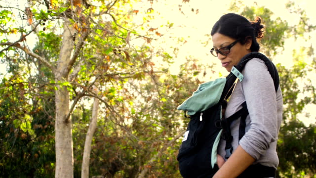 mother talks to baby in infant carrier - infarction stock videos and b-roll footage