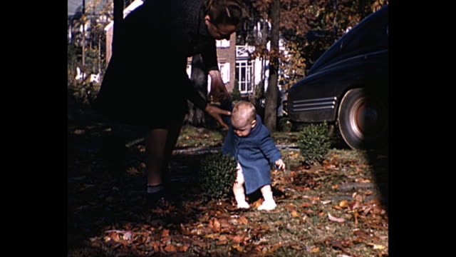1940 - mother teaches baby how to walk - 1940 stock videos and b-roll footage