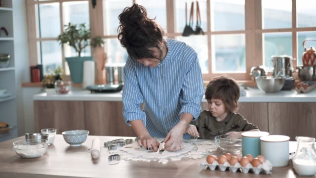 mother teaches little boy how to make gingerbread cookies - buttermilk biscuit stock videos & royalty-free footage