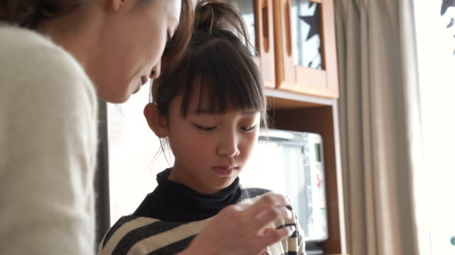 mother teaching daughter about cooking - only japanese stock videos & royalty-free footage