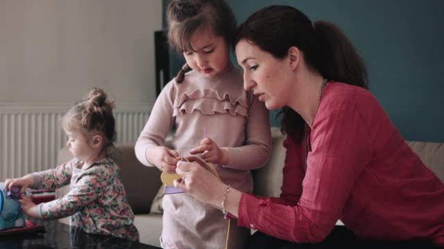 mother teaching daughter with toys - baby girls stock videos & royalty-free footage