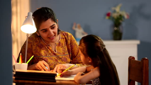 mother teaching her daughter, delhi, india - homework stock videos & royalty-free footage