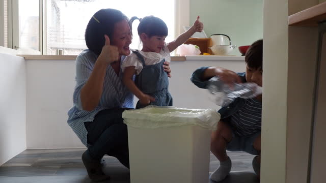 mother teaching her kids how to recycle waste - recycling stock videos & royalty-free footage