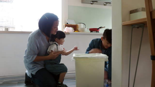 mother teaching her kids how to recycle waste - baby girls stock videos & royalty-free footage