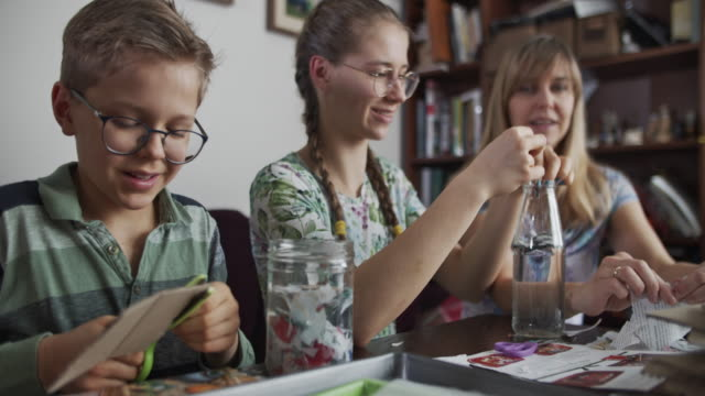 mother teaching kids how to recycle paper - art and craft stock videos & royalty-free footage