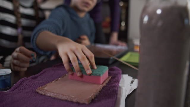 mother teaching kids how to recycle paper - pulp stock videos & royalty-free footage