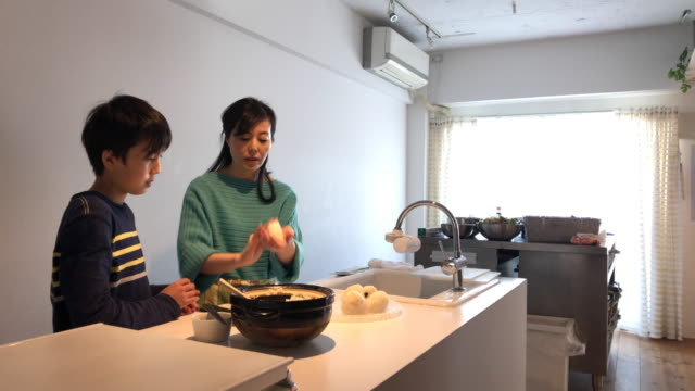 mother teaching son how to make rice balls - rice ball stock videos & royalty-free footage