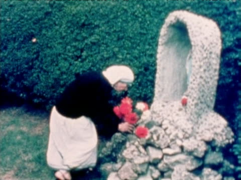 mother teresa lays flowers at shrine to virgin mary london 1973 - 1973 stock videos & royalty-free footage
