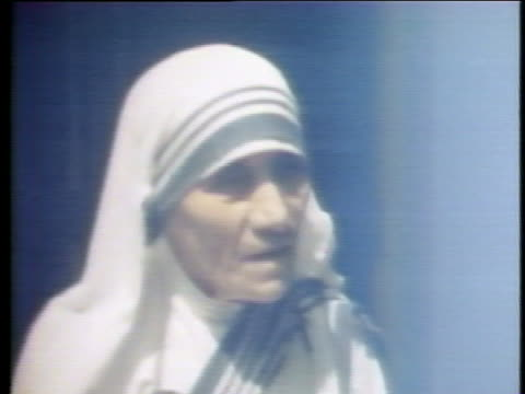 mother teresa speaks of her role in bridging the gap between the rich and poor by helping to provide homes, food and clothing to those in need, and... - healthcare and medicine or illness or food and drink or fitness or exercise or wellbeing stock videos & royalty-free footage