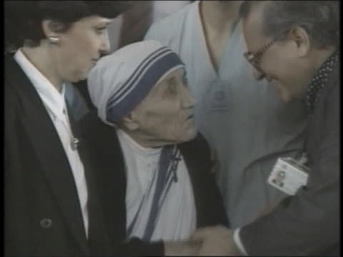 mother theresa leaves the hospital after a stay for heart trouble. - healthcare and medicine or illness or food and drink or fitness or exercise or wellbeing stock videos & royalty-free footage