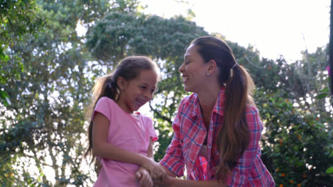 mother tickling her daughter looking very happy and laughing - tickling stock videos & royalty-free footage