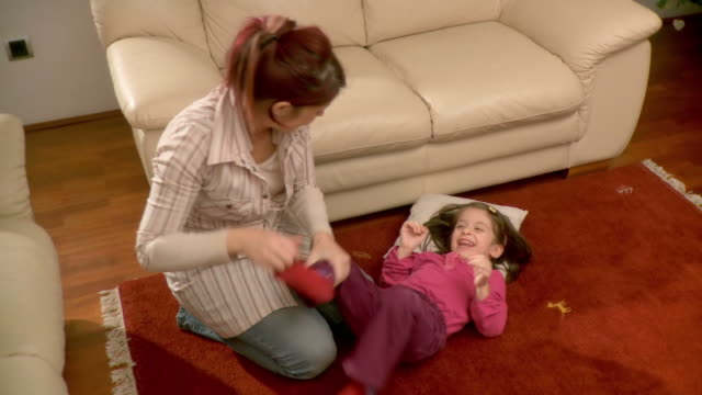 hd: mother tickling her daughter - tickling stock videos & royalty-free footage