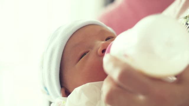 mother using bottle feeding baby newborn - nursery bedroom stock videos & royalty-free footage