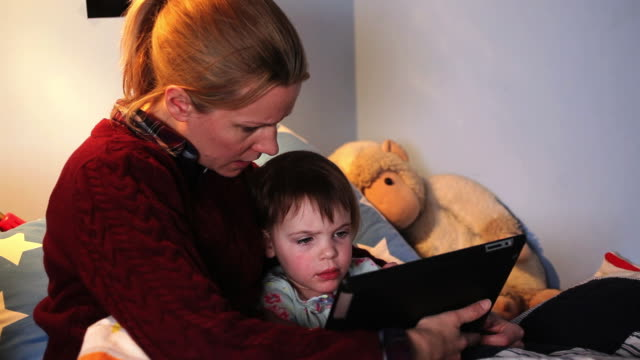 mother using digital tablet with girl - greater london stock videos & royalty-free footage