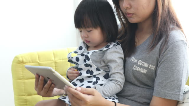 mother Using the Digital Tablet Together with child