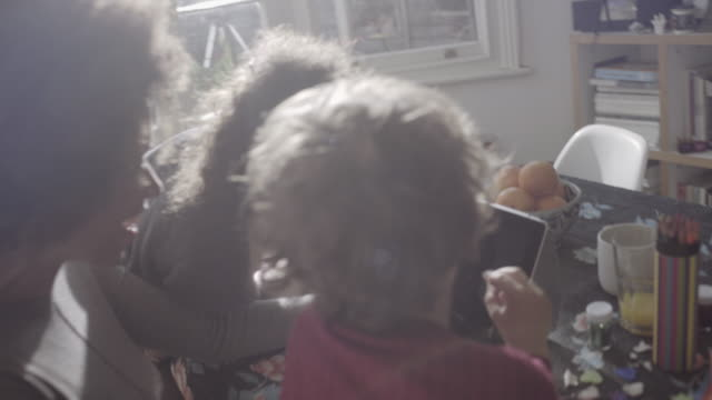 Mother video call with children and father on digital tablet