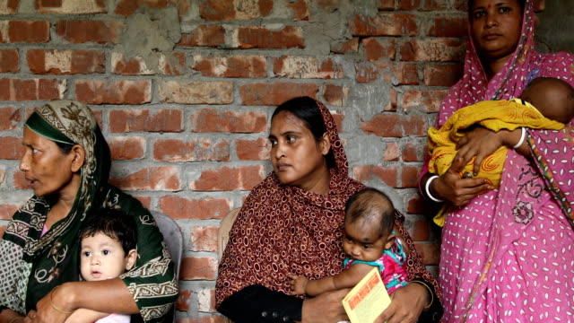 mother waits for the vaccine to her child in a rural area of bangladesh on july 20 2020 the expanded program on immunization was established in 1976... - diphtheria stock videos & royalty-free footage