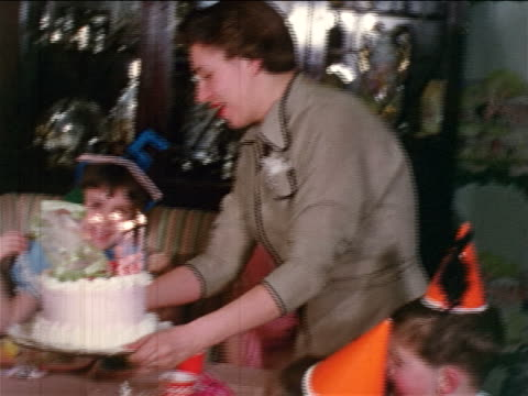 "1954 home movie mother walking into room with birthday cake / girls singing ""happy birthday"" to girl - candle stock videos & royalty-free footage"