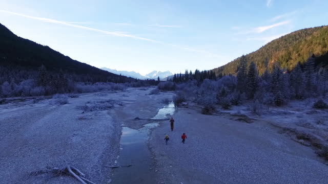 mother walking with their kids in a frozen riverbed - karwendel mountains stock videos and b-roll footage