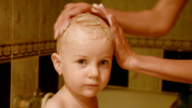 mother washing child's head - shampoo stock videos & royalty-free footage