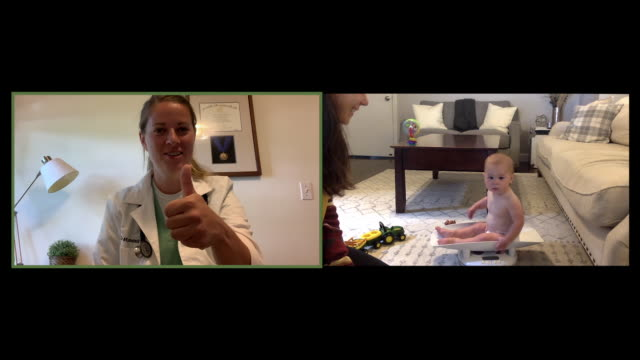 mother weighs baby on video call with pediatrician - grid stock videos & royalty-free footage