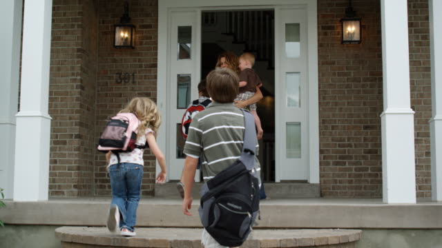 mother welcoming children home from school - see other clips from this shoot 1420 stock videos and b-roll footage