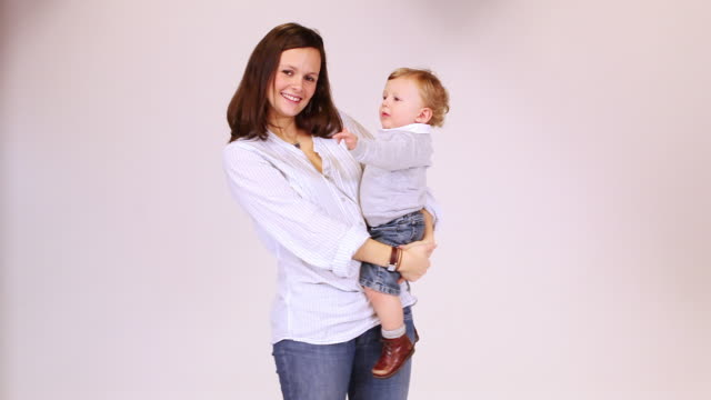 ms mother with baby boy (12-17 months) in studio / brussels, belgium - 12 17 months stock videos & royalty-free footage